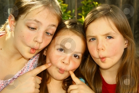 3 fish lips stock photo, Three cute girls doing fish lips by Gregory Dean