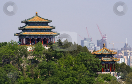 Jingshan Park Pavilions Beijing, China stock photo, Picture of Jingshan Park Pavilions taken from Beihai Park.  Jingshan Park is directly in back of the Forbidden City by William Perry