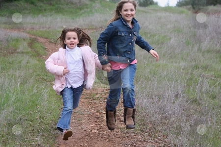 Girls running stock photo, Girls running by Gregory Dean