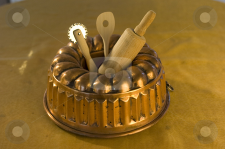 Cake tin stock photo, Cake pan with other baking utensils by Andreas Brenner