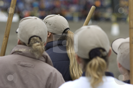 Blonde girls with grey caps stock photo, Blonde girls with grey caps from behind by Andreas Brenner