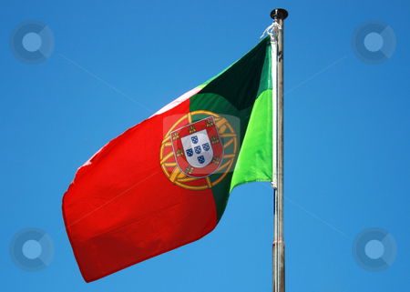 Flag stock photo, Portuguese flag on a blue sky by Marc Torrell