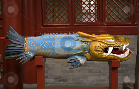 Wooden Dragon Fish Bell Fayuan Buddhist Temple Beijing China  stock photo, Wooden Dragon Fish Bell Fayuan Buddhist Temple Beijing China This wooden bell is used to call Buddhist monks to prayer. by William Perry