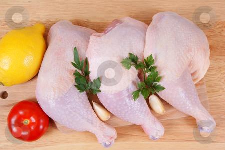 Chicken stock photo, Three chicken leg and vegetables on background by Jolanta Dabrowska