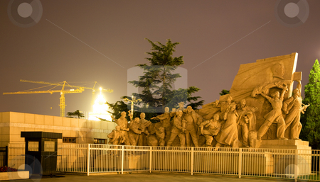 Mao Statue in front of Tomb Tiananmen Square Beijing China Night stock photo, Mao Statue in front Mao Zedong Tse Tung Tomb Tiananmen Square Beijing, China Night Shot  Yellow Building Crane in Background by William Perry