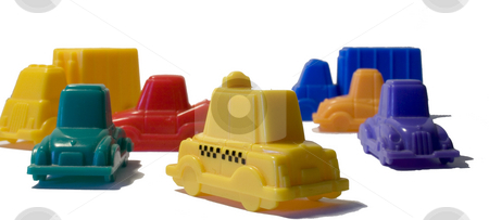 Taxi Rush  stock photo, Different colors plastic toy cars by Marc Torrell