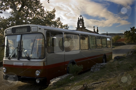 Bus stock photo, Old bus in front of a church by Marc Torrell