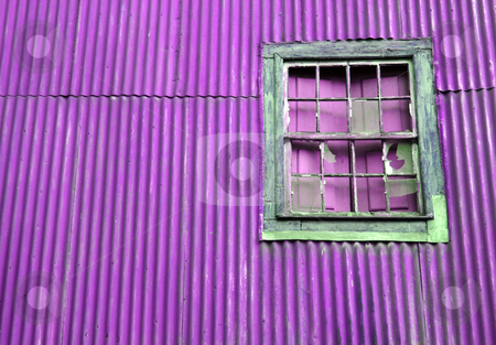 Broken window stock photo, Broken old window on a purple wall by Marc Torrell