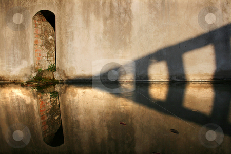 Water mirror stock photo, Reflections of a wall on a little lake by Marc Torrell