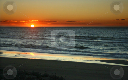 Sun rise stock photo, Sunrise on a flat beach by Marc Torrell