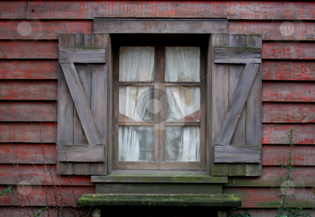 West window stock photo, Old far west red wood window by Marc Torrell