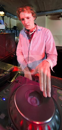 Dee Jay stock photo, The DJ at work in a discotheque, by Corepics VOF