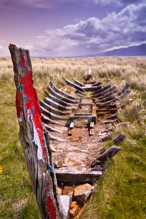 Shipwreck stock photo, Shipwreck of traditional Irish rowing boat currach by Dirk Ercken