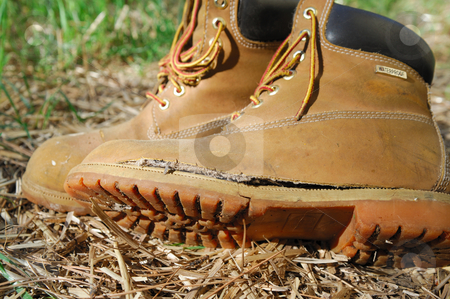 Old Work Boot stock photo, Brown leather boots that have been completely worn out from use. by Lynn Bendickson