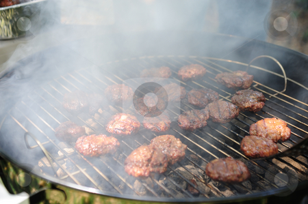Barbeque Mini Burgers stock photo, Several small hamburgers on the grill over hot charcoal covered with chedder cheese by Lynn Bendickson