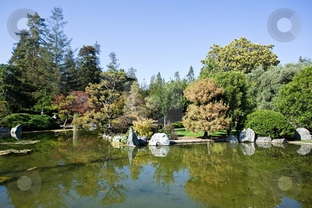Japanese Garden stock photo, Gardens in traditional Japanese style, can be found at private homes, in neighborhood or city parks, and at historical landmarks such as Buddhist temples and old castles. by Mariusz Jurgielewicz