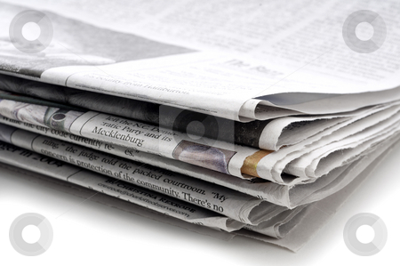 A horizontal view of a stack of folded newspapers stock photo, A horizontal view of a stack of folded newspapers by Vince Clements