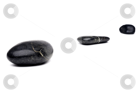 A horizontal image of 3 river rocks arranged in a diagonal line stock photo, A horizontal image of 3 river rocks arranged in a diagonal line by Vince Clements
