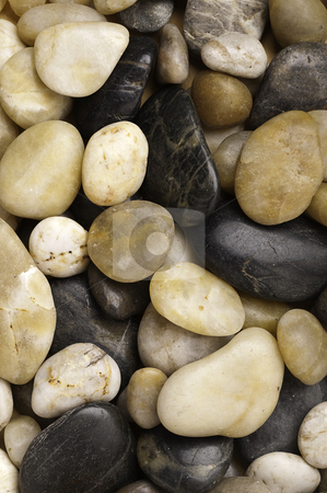 A close-up of numerous types of worn river rock stock photo, A close-up of numerous types of worn river rock by Vince Clements
