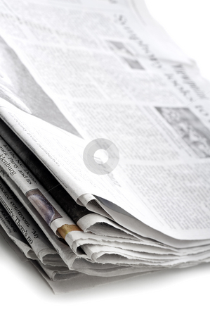 A tilted vertical view of a stack of folded newpapers stock photo, A tilted vertical view of a stack of folded newpapers by Vince Clements