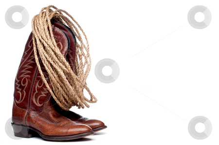 A pair of brown cowboy boots and a coil of rope stock photo, Horizontal image of a pair of brown cowboy boots and a coil of rope on a white background by Vince Clements