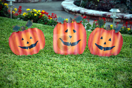 Metal face pumpkins stock photo, Three corrugated metal faces that look like pumpkins by Stacy Barnett