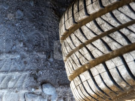 Summer tire stock photo, Closer look at the texture of summer tires, which is more expressed at the dirty road. by Sinisa Botas