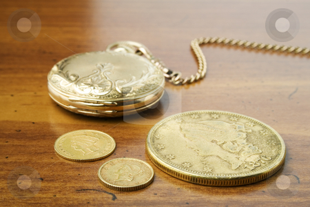 Gold stock photo, Gold watch and coins on wood table by Ira J Lyles Jr