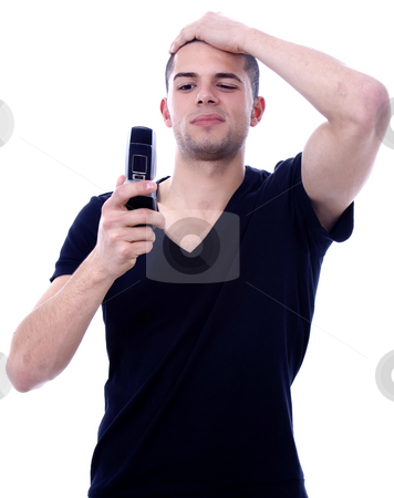 Sms stock photo, Astonished young man reading a sms by Marc Torrell