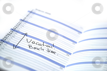 Vacation time stock photo, Daily planner showing scheduled vacation time at the beach by Albert Lozano