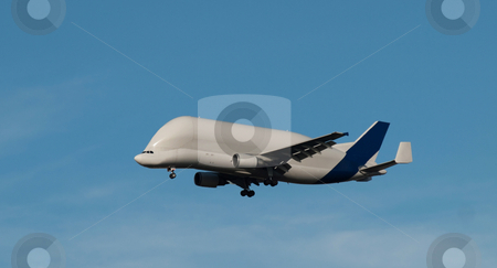 Cargo carrier stock photo, Cargo carrier fying in blue sky by Laurent Dambies