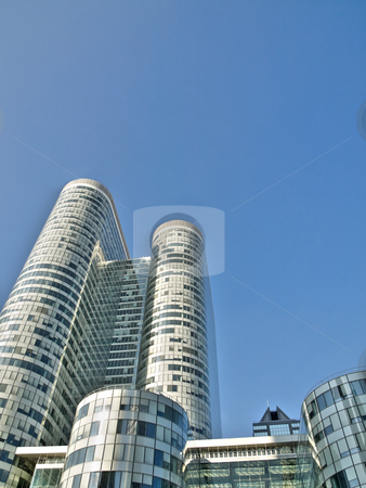 Modern skyscrapers stock photo, Skyward view of a group of skyscrapers under blue sky hdr processed by Laurent Dambies