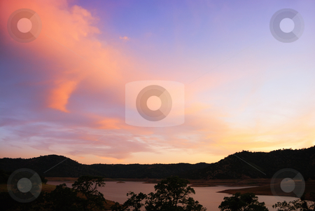 Blue and Purple Sunset Above Lake stock photo, Blue and purple sunset above the New Melones Lake in California. by Denis Radovanovic