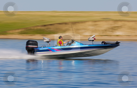 Boat speed stock photo, Fast bass boat speeding to the fishing hole by Steve Mcsweeny