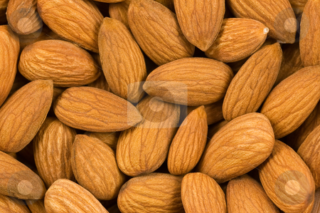 Almond nuts background. stock photo, Background of almond kernels, close up studio shot. by Pablo Caridad