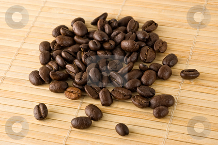 Coffee beans. stock photo, Coffee beans on a bamboo mat, close up. by Pablo Caridad