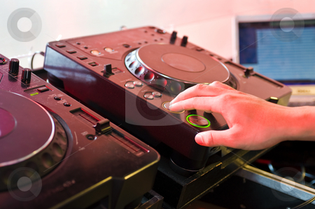 Turntable stock photo, DJ with his hands on the buttons of a turntable by Corepics VOF
