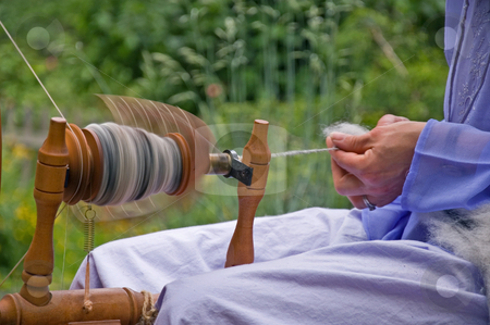 Closeup of Wool Being Hand Spun stock photo, This is a closeup of a spinning wheel in motion of hand spun yarn made from alpaca wool. by Valerie Garner