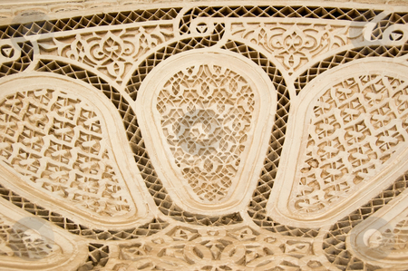 Moorish style stucco background stock photo, A detail of a Moorish style stucco in Marrakesh by Roberto Marinello