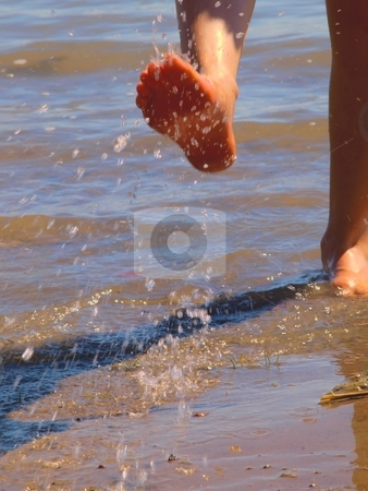 Fun at beach stock photo, A person is playing with water at the beach by Arve Bettum