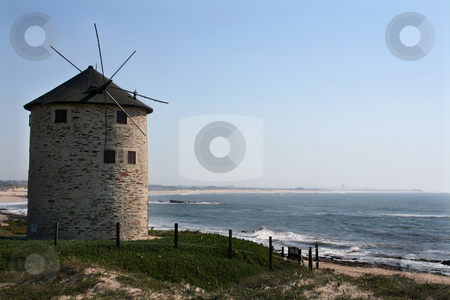 Windmill stock photo, Old windmill on a sunny coast by Marc Torrell
