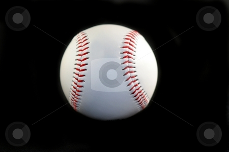 Baseball stock photo, White base ball with red lines on black background by Henrik Lehnerer