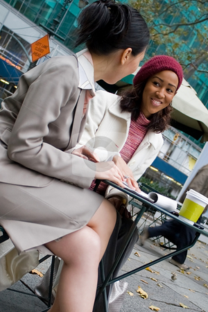 Business Meeting in the City stock photo, Two business women having a casual meeting or discussion in the city. by Todd Arena