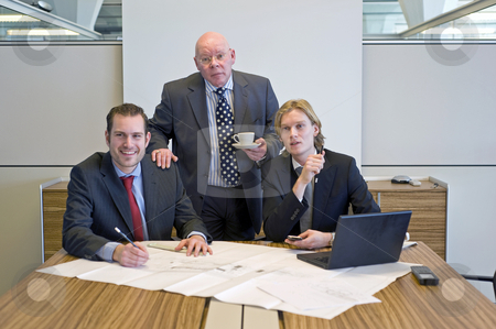 Business team stock photo, A business team working together on an architectural design by Corepics VOF