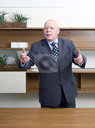 Persuasive manager stock photo, A senior manager, gesturing wildly with his hand, appearing persuasive by Corepics VOF
