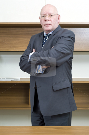 Director stock photo, Portrait of a tough looking senior manager by Corepics VOF