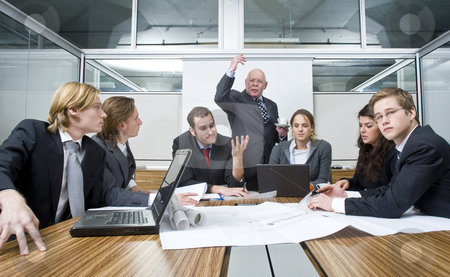 Business Disagreement stock photo, The Creative director expresses his disbelief and unhappiness about the work of his young associates during a design brief and business meeting by Corepics VOF