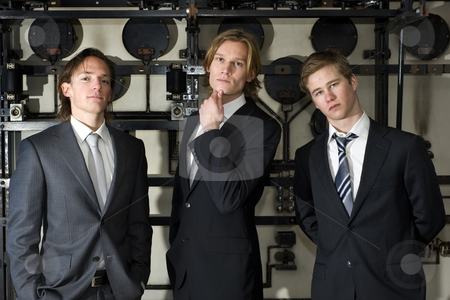 Junior Executives stock photo, Three junior executives posing arrogantly, proud of their acquired and perceived status by Corepics VOF