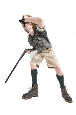 Searching Hunter stock photo, A caraciaturisation of a hunter loking for prey, dressed in a jungle attire with checkered shirt, khaki shorts, knee socks and a straw hat. by Corepics VOF
