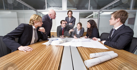 Architect cubicle stock photo, A group of six junior associates during a management team meeting with a senior manager by Corepics VOF